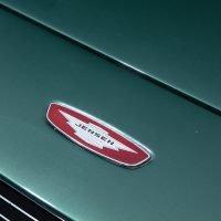 jensen logo on green car